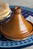 stock photo of tagine  - Moroccan tagine and bread on the table - JPG