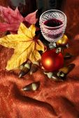 picture of beechnut  - Vintage red wine glass and bottle with fall and Christmas decorations - JPG