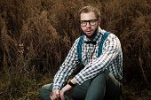 picture of redneck  - Redneck nerd man in glasses with beard outdoor - JPG