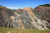 stock photo of gold mine  - massive open pit gold mine in Lead South Dakota - JPG