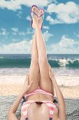 foto of legs air  - Beautiful woman legs in sandals up in the air - JPG