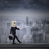 image of unawares  - Anonymous businessman with a paper bag covering his had - JPG