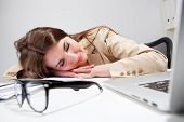 Sleeping woman at office desk