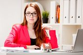 woman in glasses sitting at office