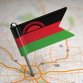 Malawi Small Flag on a Map Background.