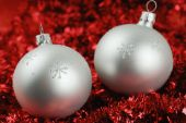 Photo Of Two Christmas Balls Over Red