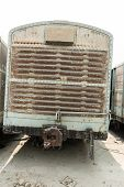 foto of railroad yard  - Grey cargo train carriage in train yard taken on a sunny day - JPG