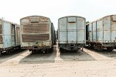 image of railroad yard  - Grey cargo train carriage in train yard taken on a sunny day - JPG