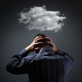 Stress, depression and despair - gloomy storm cloud above mans head