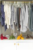 Casual Clothes On Hangers And Shoes At Shop.