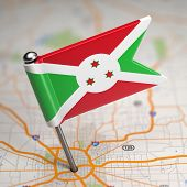 Burundi Small Flag on a Map Background.