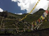 Prayer Flags On Mountains Surrounding Muktinath