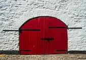 Old red wooden gate