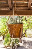 stock photo of peculiar  - Very peculiar fountain with an old Far West design - JPG