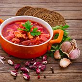 Ukrainian and Russian national Red Borscht on wooden surface, menu cooking recipes.