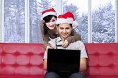 Couple Buy Online In Winter Day