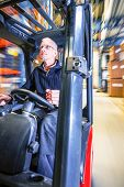 working in a warehouse on a forklift