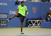 Professional tennis player Gael Monfis using the Tweener during quarterfinal match at US Open 2014