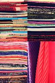 Stack of colorful fabric. Set of vertical images