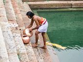 Temple Priest Washing Pots