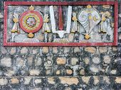 Shanka, Chakra and Tilak Mural on Temple Wall.