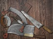 faded colors of a vintage kitchen knives and sharpening tools collage over old wooden table, space for your text