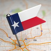 stock photo of texas map  - Small Flag of Texas on a Map Background with Selective Focus - JPG