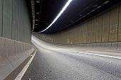 Interior of an urban tunnel without traffic in hong kong modern city at night