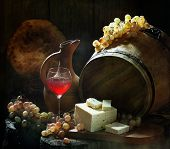 Still-life with cheese and wine and grapes