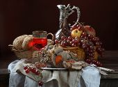 Still-life with a boiled pork wine and fruit