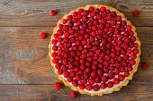 image of tort  - Delicious raspberry tart on a wooden board - JPG