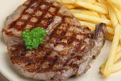 Rib-eye beef steak served with fries.