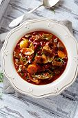 Beef goulash with mushrooms and vegetables