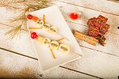image of christmas meal  - Fruity Christmas dessert set up and decorated as a kid meal - JPG