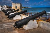 stock photo of slave  - Cannons overlooking from Cape Coast Castle - JPG
