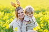 Little Toddler Boy And His Mother In Easter Bunny Ears Having Fun