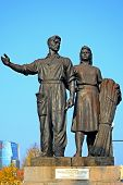 Worker And Farm Woman Statues On The Green Bridge