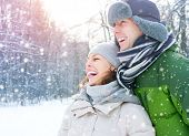 Winter couple. Happy Couple Having Fun Outdoors. Snow. Winter Vacation. Outdoor
