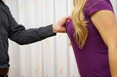 Man  Pulling His Girlfriend's Shirt, Violence Concept Over Woman