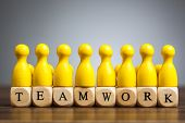 Toy Pawn Figure Concept: Strength, Success Through Teamwork