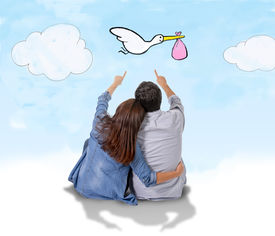 image of baby delivery  - young attractive Hispanic couple on floor pregnant woman sitting together handsome husband and flying stork bringing baby in pregnancy and family growth concept - JPG