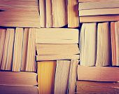 picture of instagram  - image of a stack of paperback books on the end of the pages toned with a retro vintage warm instagram like filter app or action effect - JPG