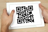 stock photo of qr codes  - Hand holding tablet with QR code on screen - JPG