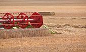 Combine Harvestor Blades Working In Field