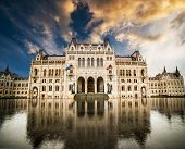 stock photo of hungarian  - Hungarian Parliament building with reflection  at sunset in Budapest - JPG