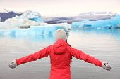 image of serenity  - Freedom happy woman at glacier lagoon on Iceland serene and blissful - JPG