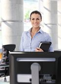 stock photo of secretary  - Portrait of happy mid adult casual brunette caucasian secretary at business office - JPG
