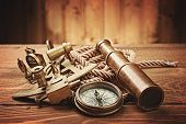 image of spyglass  - vintage  still life with compass - JPG