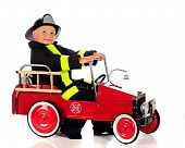 pic of fire truck  - An adorable preschool fireman dressed and ready for a fire in his truck - JPG
