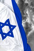 stock photo of israeli flag  - Israeli waving flag on a bad day - JPG
